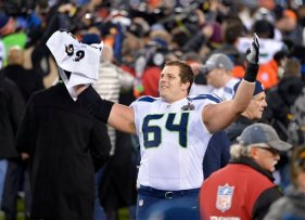Seattle Seahawks' J.R. Sweezy (64) celebrates during the second half of the NFL Super Bowl XLVIII football game against the Denver Broncos, Sunday, Feb. 2, 2014, in East Rutherford, N.J. (AP Photo/Bill Kostroun)